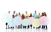 istock Large group of people holding umbrellas. 184398070