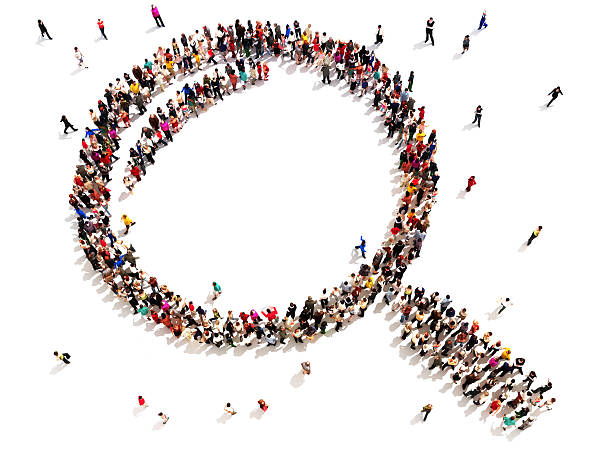 Large group of people in the shape of a magnifying glass. Searching, investigating or analyzing concept on a white background. finding stock pictures, royalty-free photos & images
