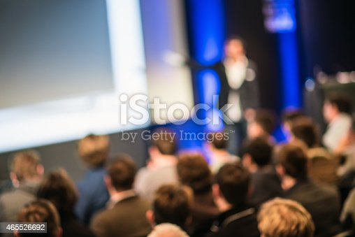 istock Large Group of People Listening to a Presentation 465526692