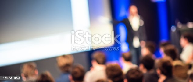istock Large Group of People Listening to a Presentation 469237930