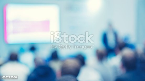 526272636istockphoto Large Group of People Listening to a Presentation 526272586