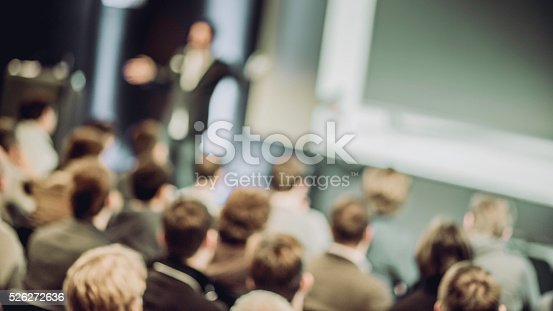 526272636istockphoto Large Group of People Listening to a Presentation 526272636