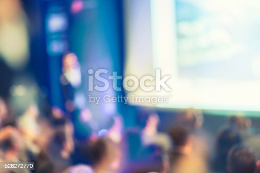 526272636istockphoto Large Group of People Listening to a Presentation 526272770