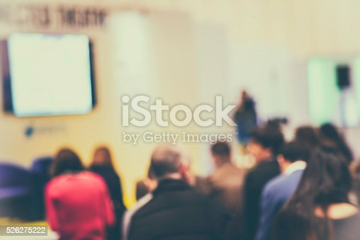 526272636istockphoto Large Group of People Listening to a Presentation 526275222