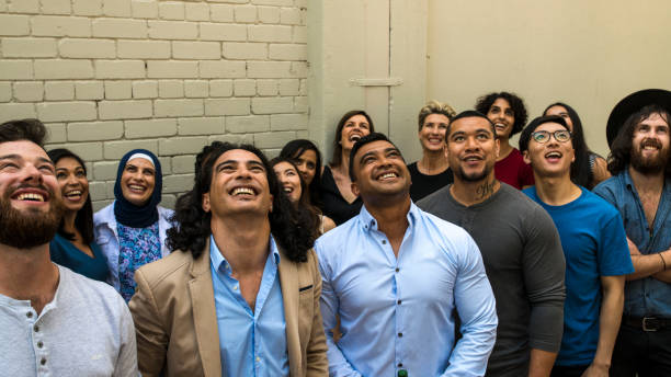 Large group of people looking up stock photo