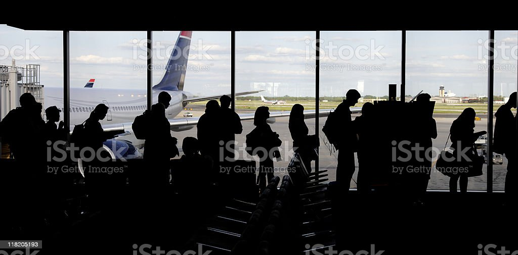 large group of people queuing - silhouette stock photo