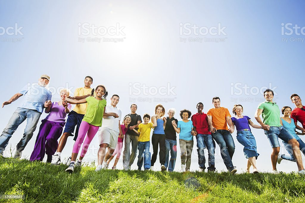 Large group of people running against sky. royalty-free stock photo