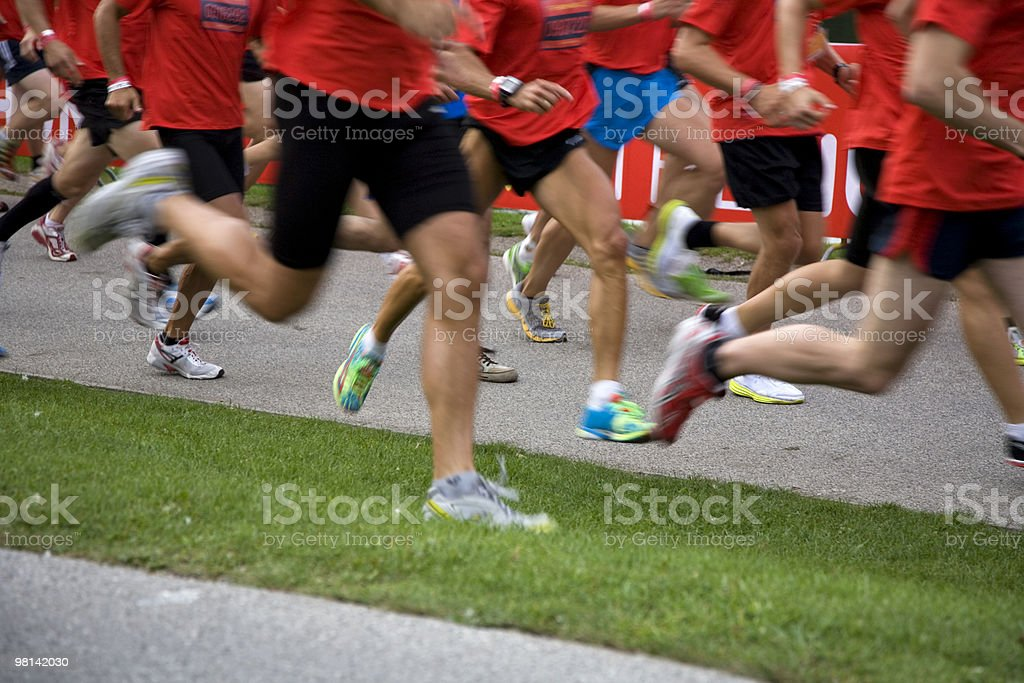 large group of people running marathon royalty-free stock photo