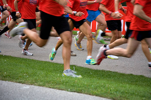 large group of people running marathon stock photo