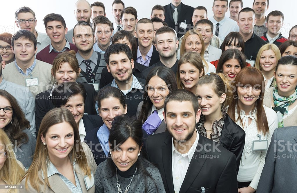 Large group of people smiling in camera stock photo