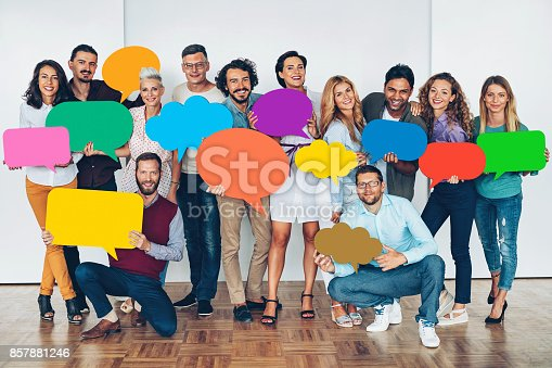 638013502istockphoto Large group of people with colorful speech bubbles 857881246