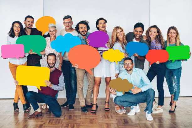 Large group of people with colorful speech bubbles stock photo