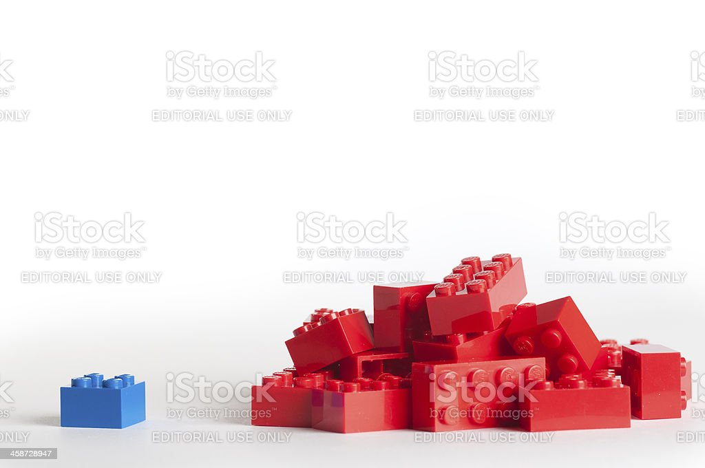 Large group of red lego blocks and one blue block royalty-free stock photo