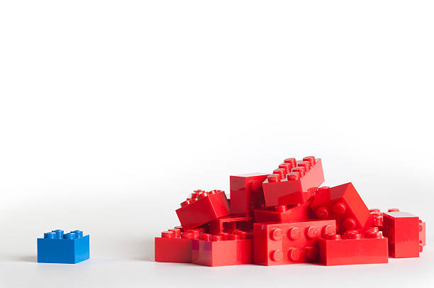large group of red lego blocks and one blue block - lego stockfoto's en -beelden