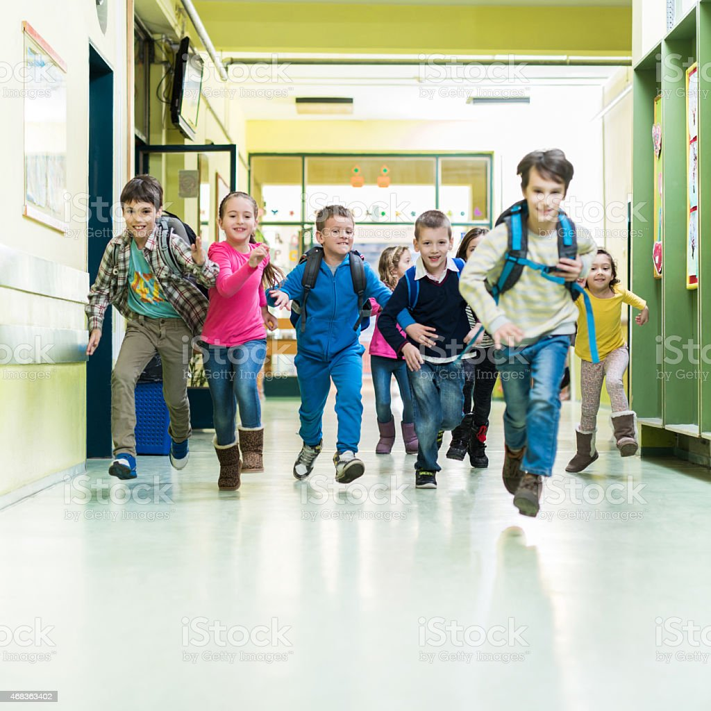 Kids Stock A Wide Selection Of Luxury Premium Cotton: Large Group Of School Children Running In The Hall Stock