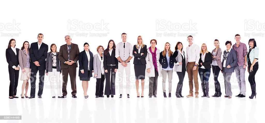 Large group of smiling business people in a line. stock photo