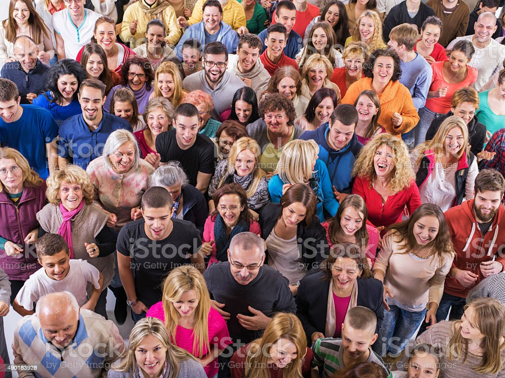 Large group of smiling people running together. stock photo