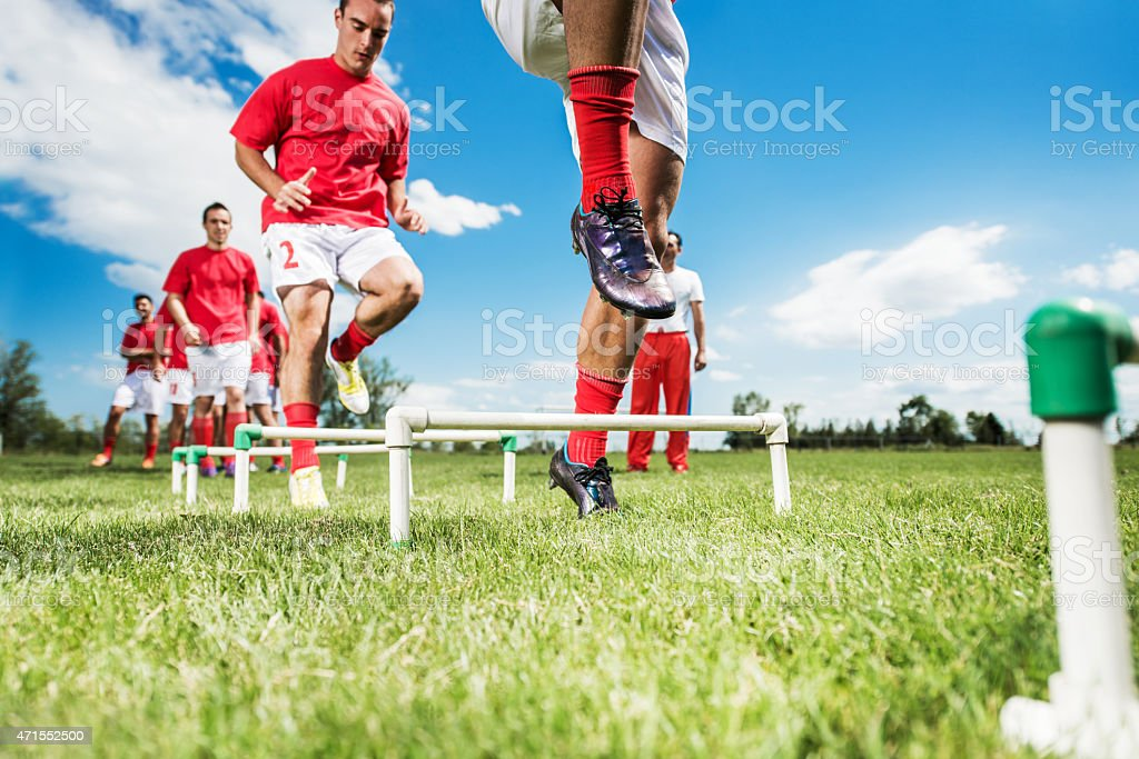 Large group of soccer players having training. stock photo