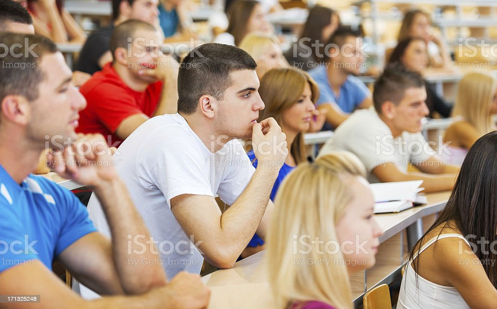 Large group of students listening to a lecture royalty-free stock photo