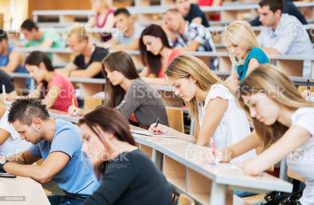 Large group of students writing in notebooks. royalty-free stock photo
