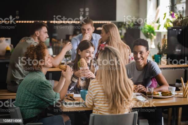 Large group of university students communicating while eating on a picture id1038314998?b=1&k=6&m=1038314998&s=612x612&h=dnffoevtsko7na04jbg7yiex8a0z4rfhemu7wvxvlcu=