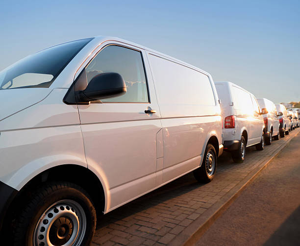 Large group of Vans / Transporters close up of white vans in a row, transportation concept caravan photos stock pictures, royalty-free photos & images