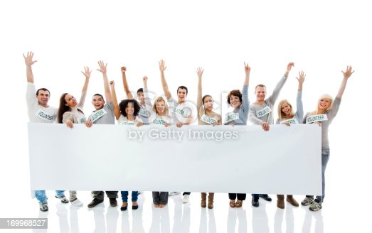 638013502istockphoto Large group of  volunteers holding a big white board. 169968527