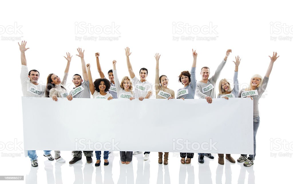 Large group of  volunteers holding a big white board. stock photo