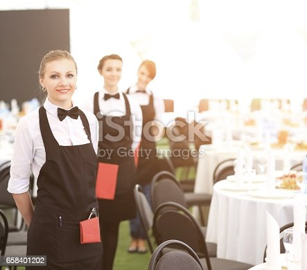 istock A large group of waiters and waitresses next to served tables 658401202