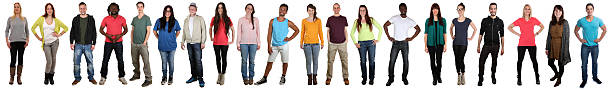 Large group of young people smiling happy multicultural multi ethnic Large group of young people smiling happy multicultural multi ethnic full body portrait standing in a row isolated on a white background people in a row stock pictures, royalty-free photos & images