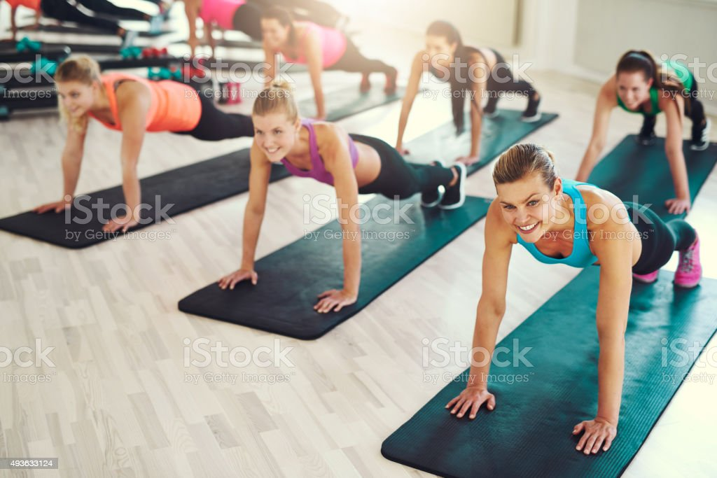 Large group of young women working out stock photo