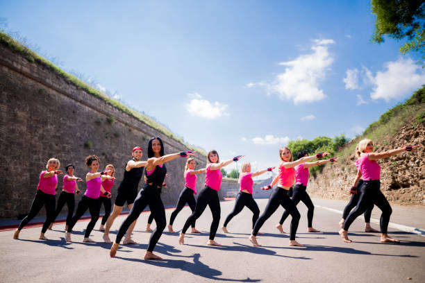 Large group piloxing practice outdoors