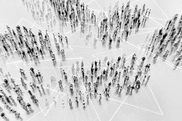 Large groups of people communicating stock photo