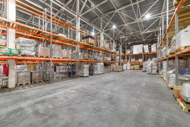 Large hangar warehouse industrial and logistics companies. Large hangar warehouse industrial and logistics companies. Warehousing on the floor and called the high shelves. distribution center stock pictures, royalty-free photos & images