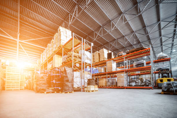 large hangar warehouse industrial and logistics companies - warehouse stock photos and pictures