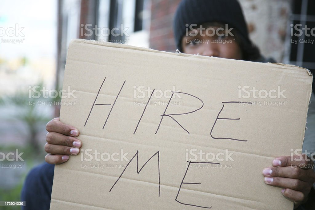 Large Hire Me Sign Held by unemployed man on street royalty-free stock photo