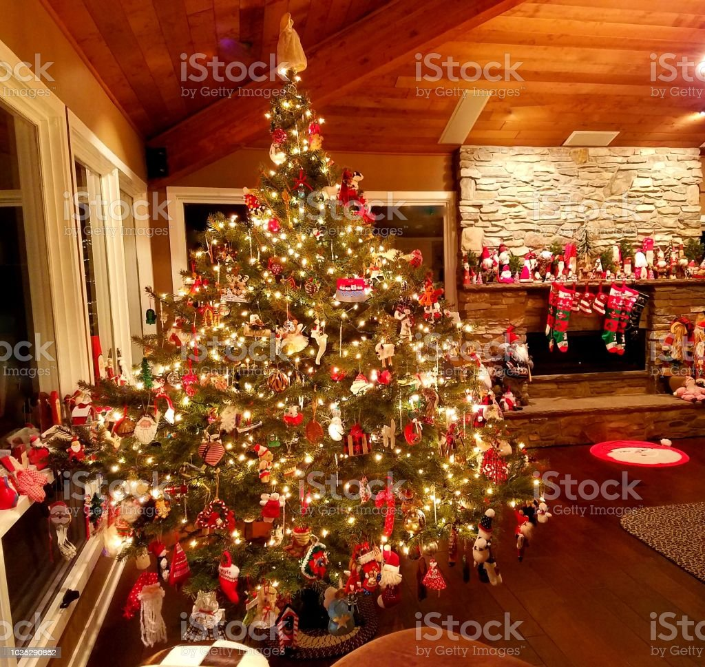 Beautifully decorated large Christmas Tree with white lights and...