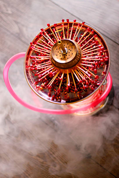 Large hookah and red pomegranate seeds from above stock photo