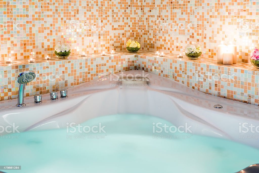 Large Jacuzzi With Water And Burning Candles stock photo 479681284 ...