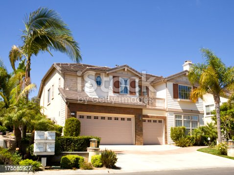 697393252 istock photo Large house next to palm trees in California 175585927