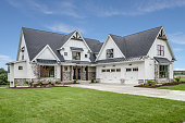 istock Large house with steep roof and side entry three car garage 1272163106