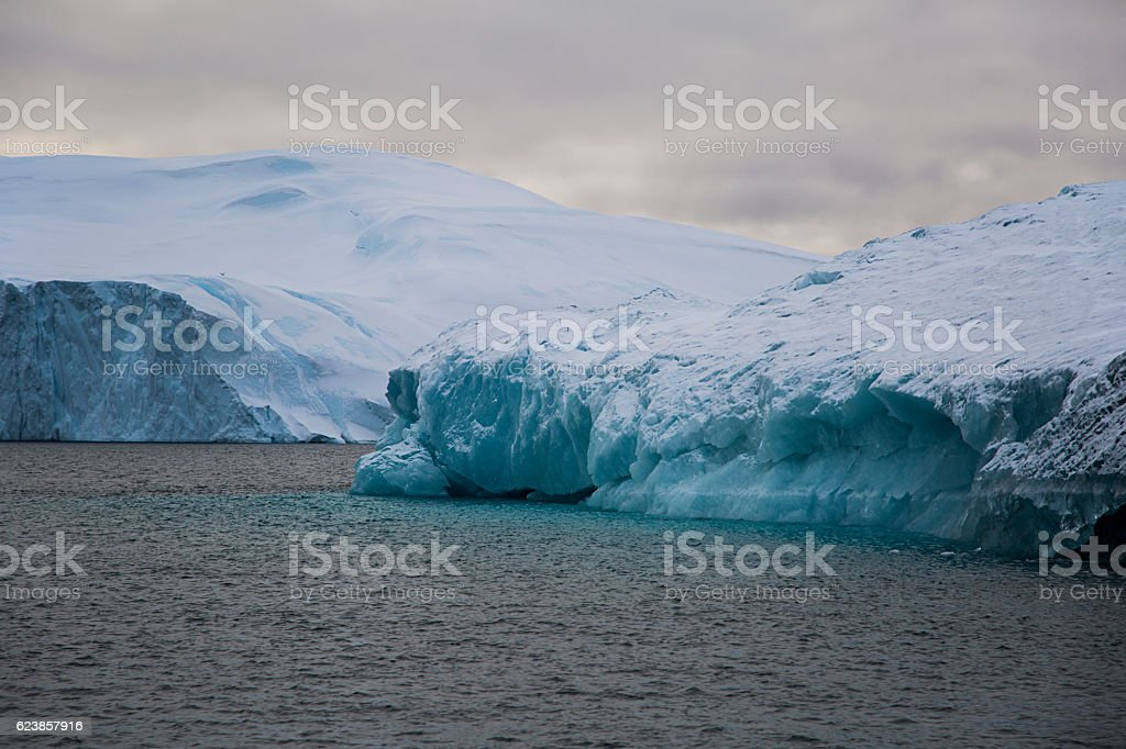 Large iceberg covered with snow stock photo