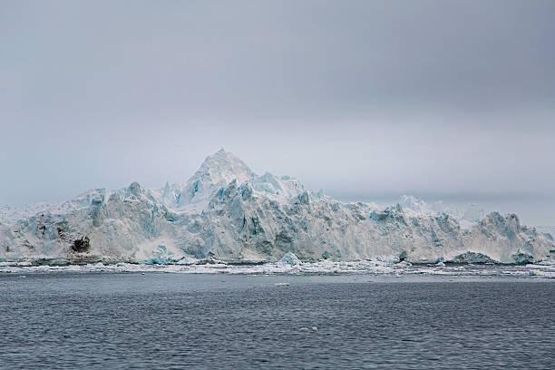 Large iceberg with rough peaks stock photo