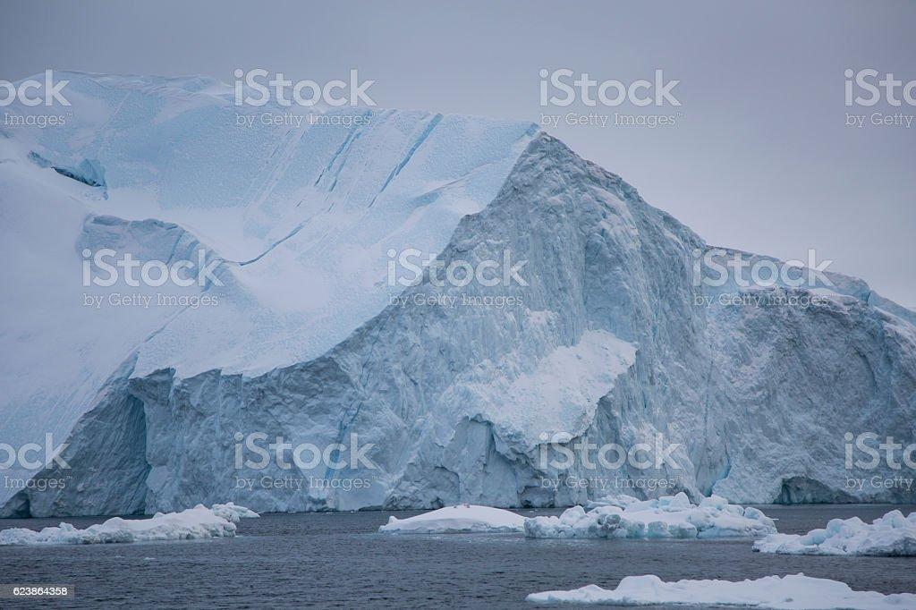 Large iceberg with smaller floe stock photo
