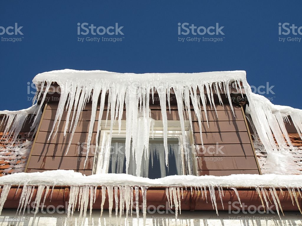 Large icicles hanging from the roof royalty-free stock photo