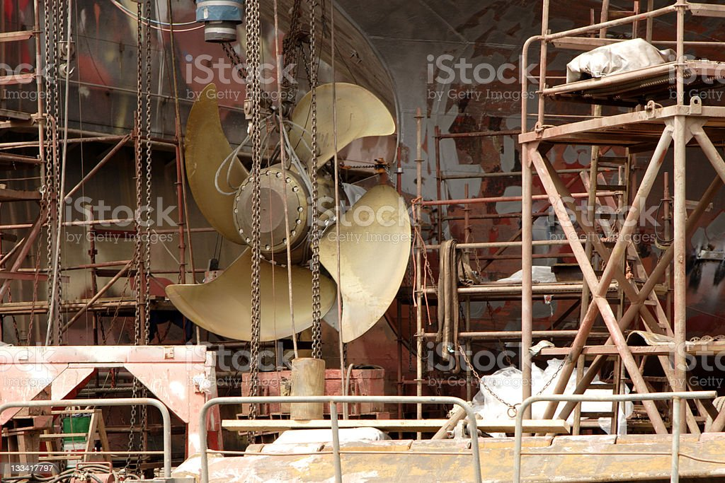 Large industrial metal fan surrounded by other metal objects stock photo