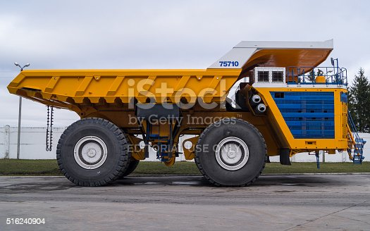 istock Large Industrial Mining Dump Truck BelAZ Background 516240904