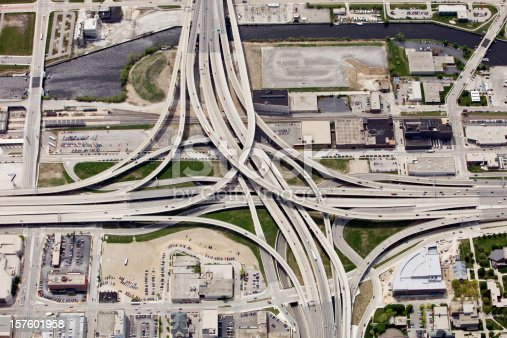 Aerial view of a large interstate highway interchange in the downtown area of Milwaukee, Wisconsin. Shot from the open window of a small airplane.