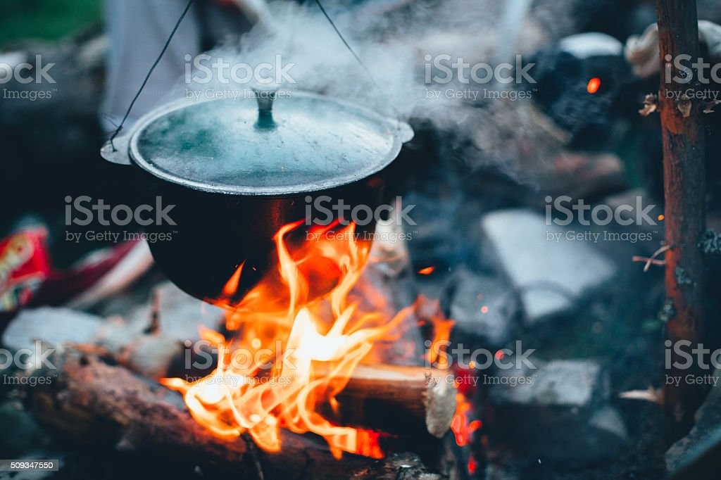 Large kettle on fire stock photo