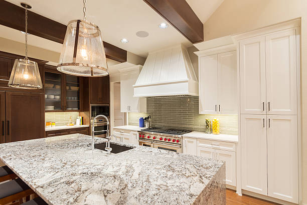 Large Kitchen in Luxury Home with Island large furnished kitchen in new home quartz stock pictures, royalty-free photos & images